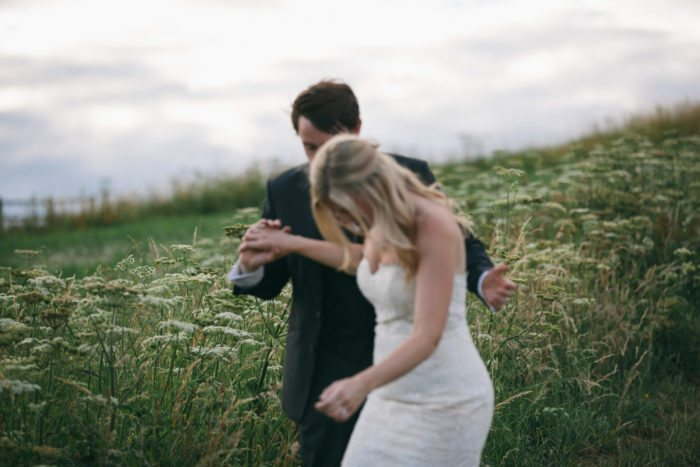 wedding couple walking in fields