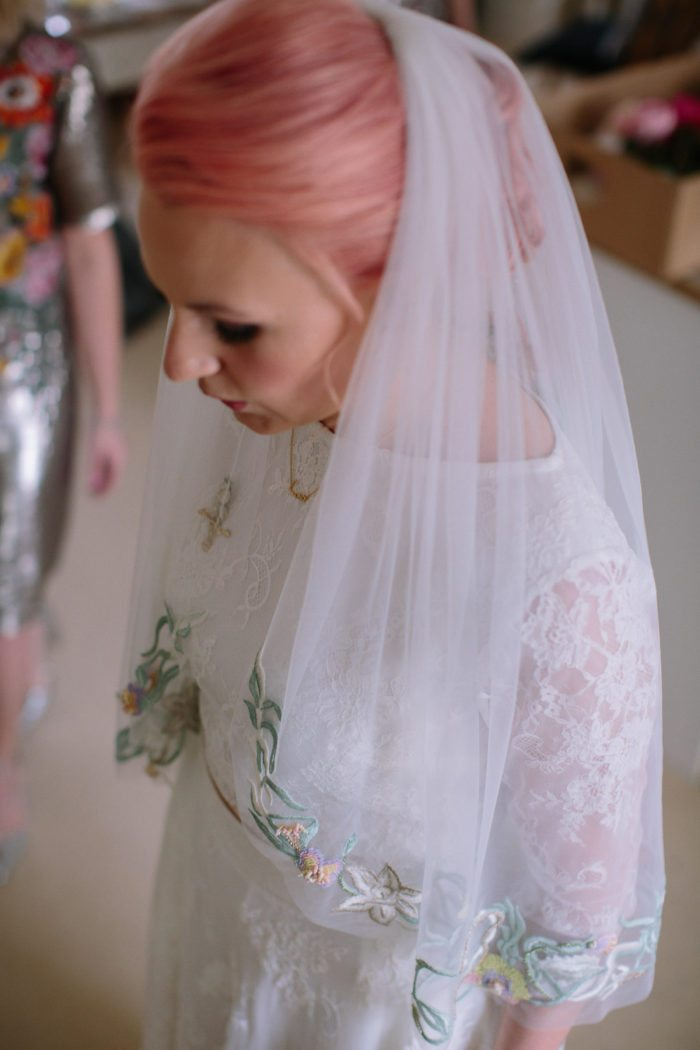bride with pink hair and veil