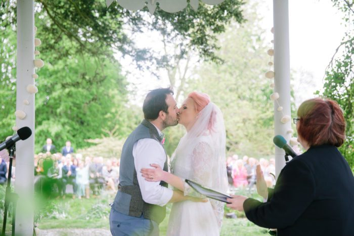 first kiss wedding couple