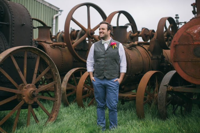groom portrait with vintage tractors