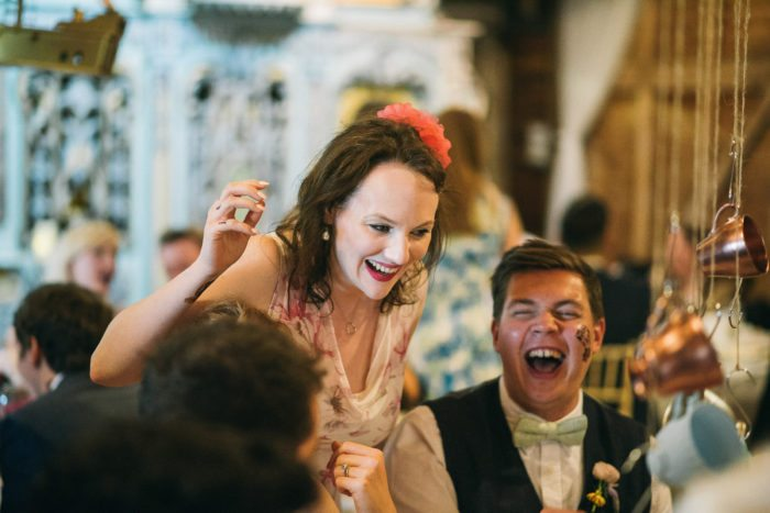 guests laughing at a wedding