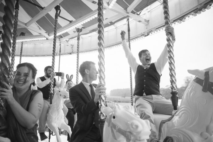 Funfair Wedding Guests On Carousel