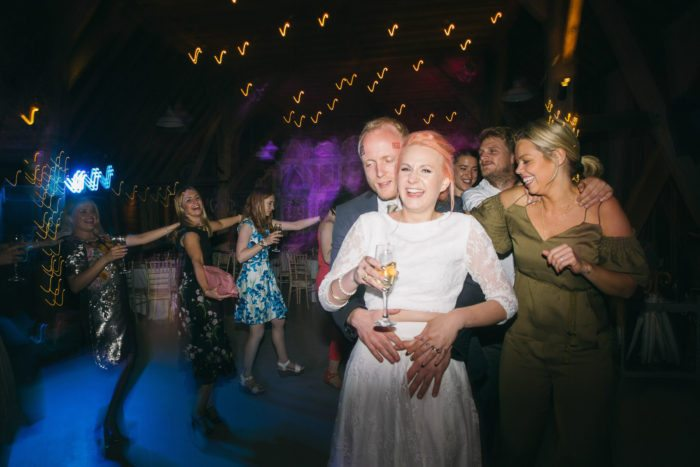 wedding on the dancefloor - bride dancing with drink