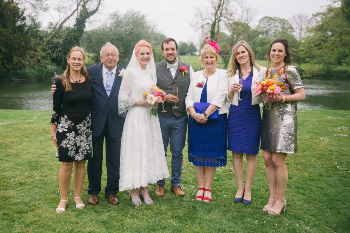 Group family portrait at funfair wedding