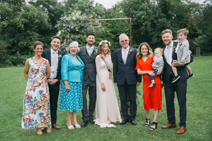 Relaxed group family photograph at wedding